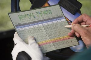 Golfer Marking Score on Scorecard